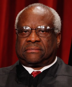 grim looking black judge scowling into the camera